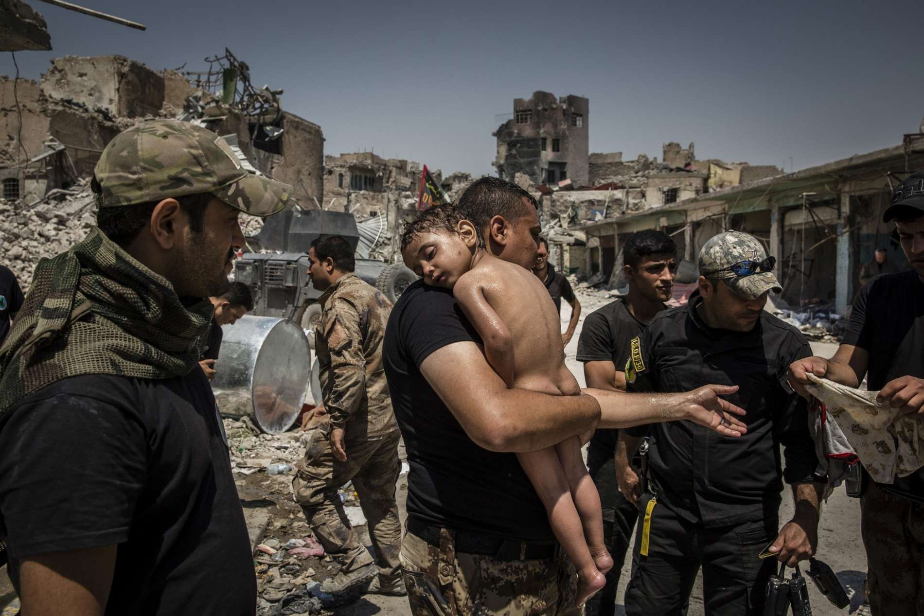 The Battle for Mosul - Young Boy Is Cared for by Iraqi Special Forces Soldiers © Ivor Prickett
